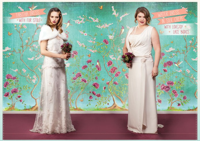 Photo of two gorgeous brides standing in front of exquisite green and pink floral wallpaper designed by Mary Adams